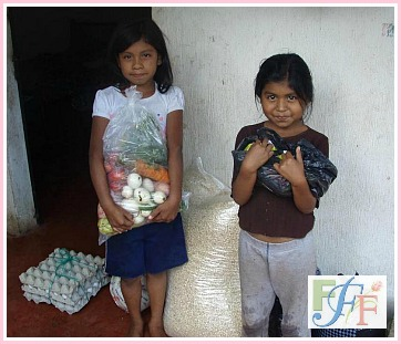 Two of Catarina's daughters with FFF food donations.